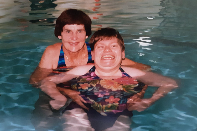 Photo is Bette in the pool in 1997 with Sharon, a person who is supported by Ongwanada.
