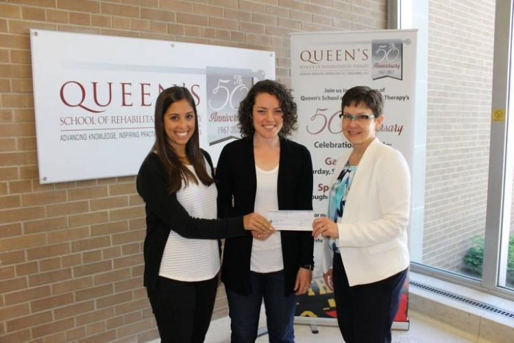 SRT Director, Dr. Marcia Finlayson (R) accepts commitment cheque from 2016 PT Candidates, Arlee Stern (L) and Heather Greene (C)